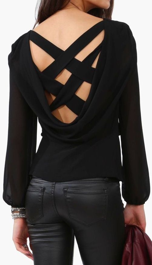 Black shirt with balloon sleeves and criss-crossed straps and black leather pants (Necessary Clothing)