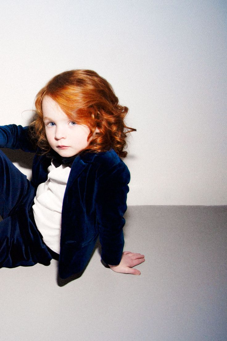 cool stylish in blue with bowtie and great red hair!