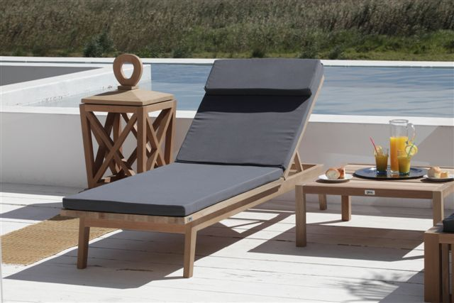 Coral sun lounger and Bloc Outdoor feature lantern..
