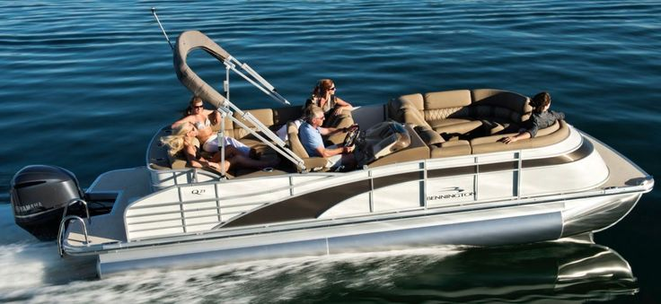 The 2016 Bennington 2350 QCL in metallic white with metallic sorrel accents. Upholstery in Affluence Tuscan Dune. This is a true luxury pontoon boat.