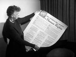 Eleanor Roosevelt holds the Universal Declaration of Human Rights