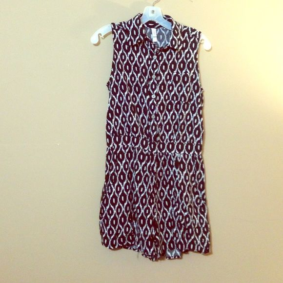 Black patterned romper Black and white patterned button down romper with a collar. Sleeveless with slightly tapered waist. Bonus: it has pockets!! Xhilaration Pants Jumpsuits & Rompers