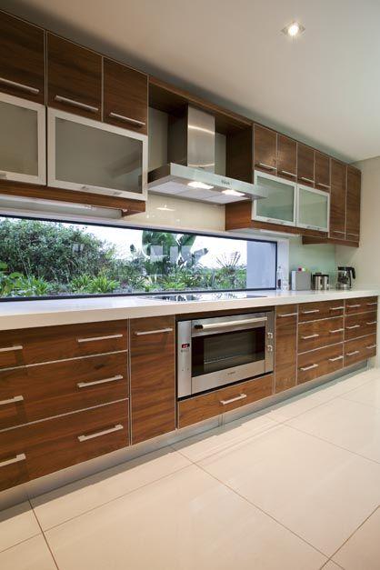 Caesarstone kitchen top, wooden finish cupboards, white tiles
