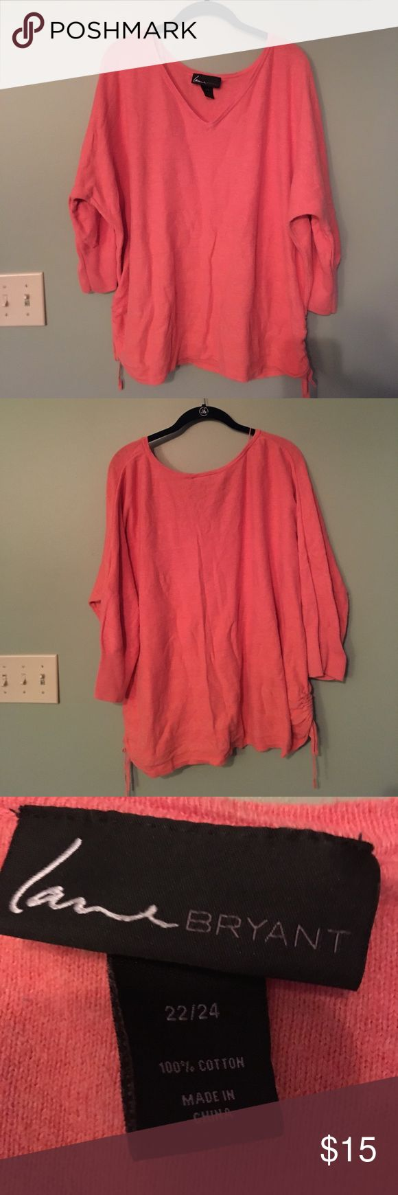 Lane Bryant size 22/24 coral sweater w/ ruching Lane Bryant size 22/24 coral sweater.  Sweater has sewn in stripe details and ruching on the bottom of each side that can be tied.  This is in excellent used condition- was only worn a few times.  It comes from a smoke free and pet free home. Lane Bryant Tops Tunics