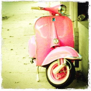 Awesome picture of a pink moped.