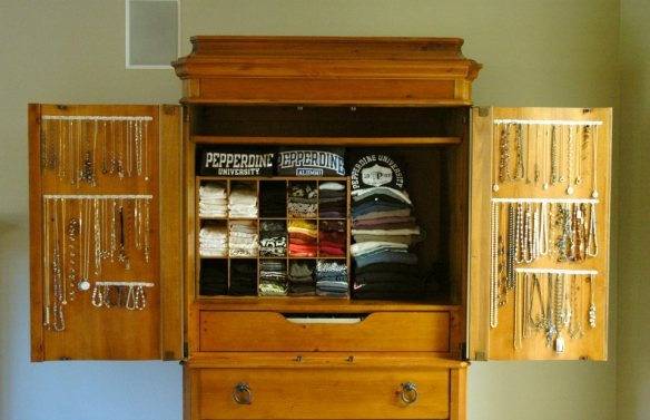 New Use for an Old Armoire. I converted an old entertainment cabinet into a place to store my tank tops/tshirts and organize my jewelry. Full description on my blog: http://thisingo.com/2012/01/08/new-use-for-an-old-armoire/