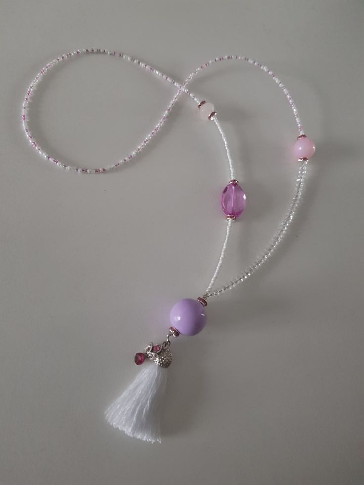 Bohemian style asymetric tassel necklace in white, pink and lilac
