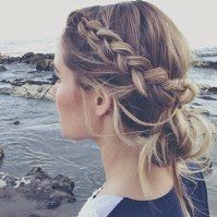 Lauren Conrad's easy dutch beachy braid into a messy bun is a great look for this summer!