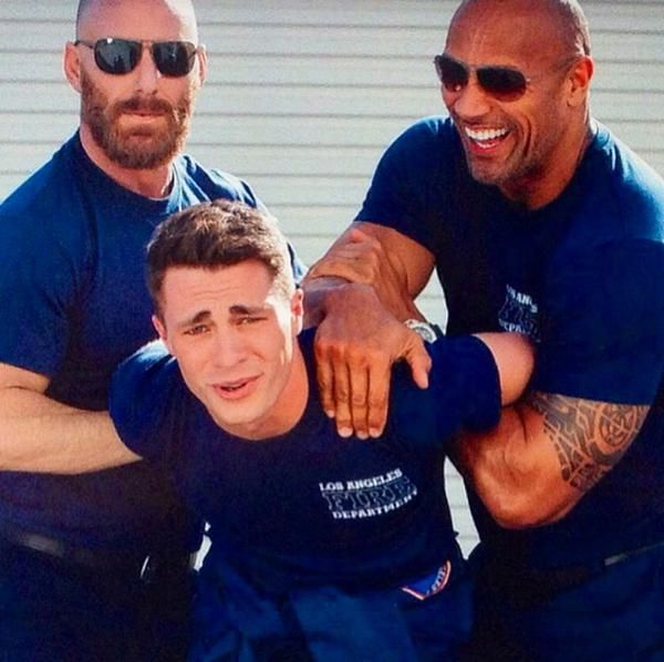 Colton Haynes gets manhandled by his San Andreas co-star the Rock
