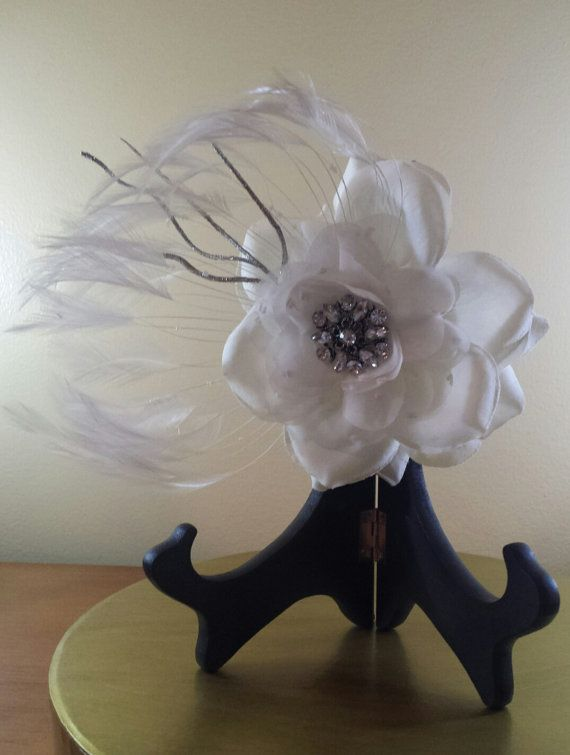 Ivory bridal fascinator with silver bling and feather accents. This piece is sophisticated and beautiful. Measures roughly 8 by 6 and is mounted