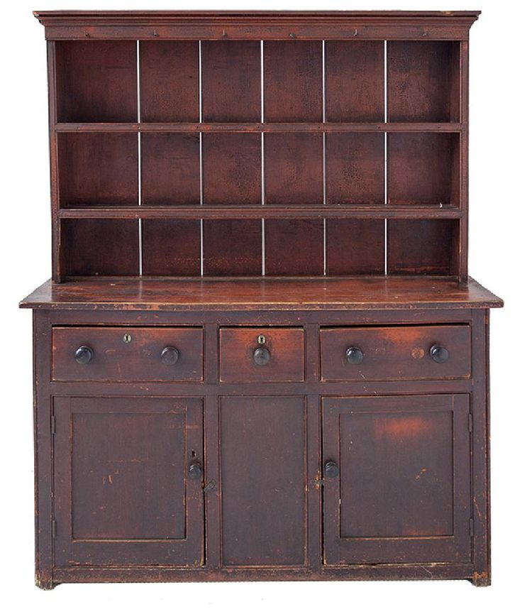 """Pennsylvania, In original red painted finish, two piece with stepped cove molded crown, over two open shelves, resting on base with solid ends and three dovetailed drawers with original boldly turned knobs, over two paneled doors with original knobs and blind panel between, with two shelves on interior, cut-out feet and apron, original wrought iron hangers below crest for tankards/cups, 59 1/4 x 19 x 72 1/2"""" high. Please mote that this piece was passed down from Pennsylvania relatives."""