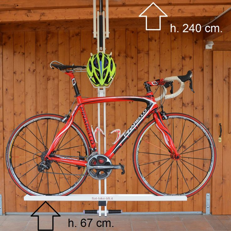 pneumatic lift bike rack stores bicycle and helmet flat against ceiling of home or garage. Black Bedroom Furniture Sets. Home Design Ideas