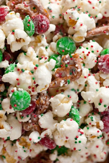 Christmas Crunch - 1/2 c. popcorn kernels (or 2 bags microwave white popcorn), 1 1/3 c. broken pretzel pieces, 1 12-oz bag Christmas M&Ms drizzled & stirred with 1 12-oz bag melted Vanilla candy melts; then spread in single layer onto wax paper & sprinkled with Christmas colored sprinkles.