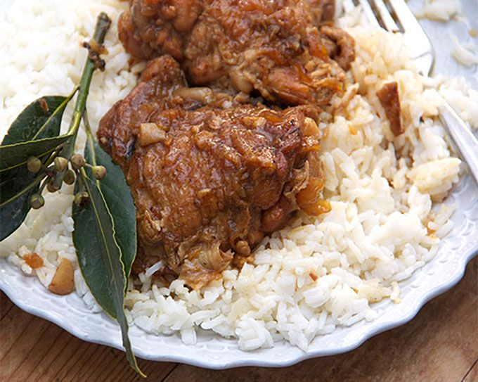 If you like tender falling-apart chicken in a tangy, vinegary garlic sauce, served over rice, this Chicken Adobo recipe from the Philippines is for you.