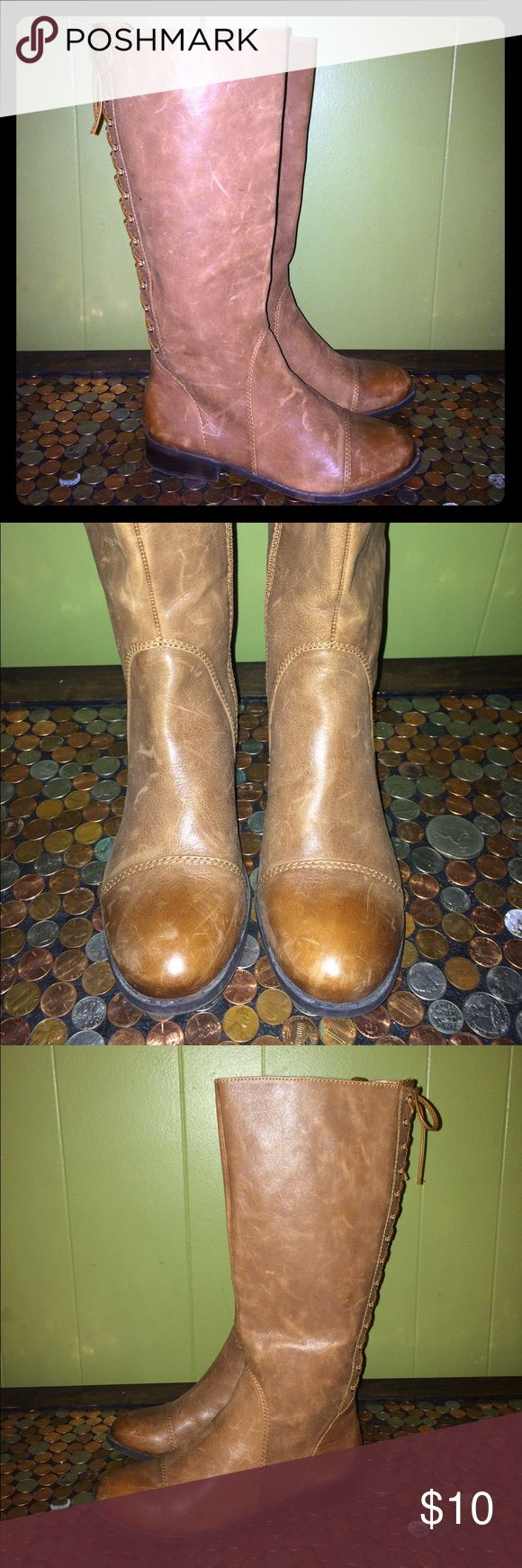 Jessica Simpson Brown Rear Lace Knee High Boot 7 Jessica Simpson Brown Leather Rear Faux Lace Knee High Boot. Ladies Size 7. Inner Leg Zip. Good Clean Condition, Lots Of Wear Left. Questions Welcome Thanks For Looking. Jessica Simpson Shoes Combat & Moto Boots