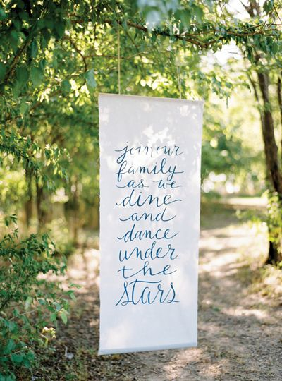 oversize banner inviting guests to dinner | Ryan Ray #wedding