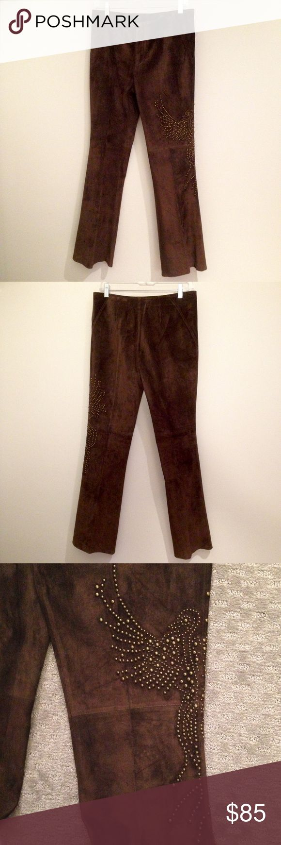 """Brown Suede Studded Flared Pants by David Neal 100% leather (actually, buttery suede) w metal stud embellishments down the left leg -- they look like metal, but could perhaps be a high grade of plastic. I'm not sure, so I mention it. Flared & fully lined, with a seam around the knees & triangular seams on either side of the waist. 31"""" inseam. Excellent condition -- they've never been worn. NWOT vintage. Really beautiful pants! David Neal Pants Boot Cut & Flare"""