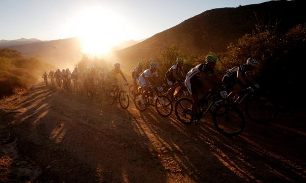 Some of the world's top professional cyclists during the first major climb on stage one of the ABSA Cape Epic Mountain bike race near Citrusdal, South Africa. The race is considered the Tour de France of mountain biking, with 1,200 riders taking on 698km of racing. Photograph: Kim Ludbrook/EPA