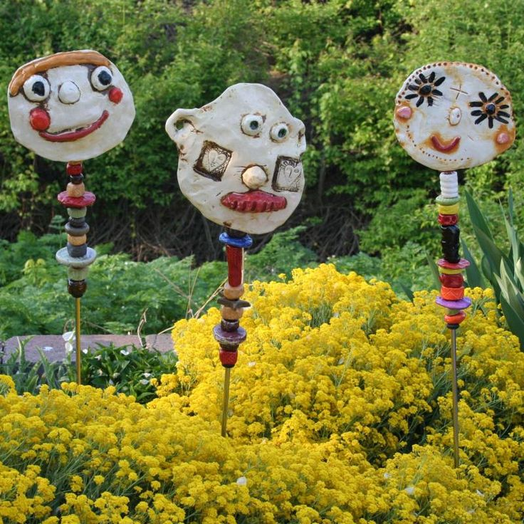 Granville Art Affair & Wine Festival - garden totems with clay faces Love these!!!!!!