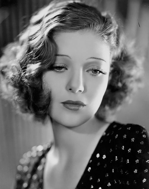 Loretta Young - Finger waves in the 30s were often brushed through and looked more relaxed than in the 20s