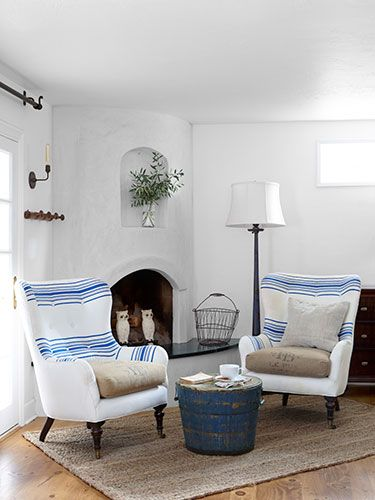 Bright idea: This homeowner clad her bedroom chairs in not one, but two antique fabrics from textiletrunk.com.