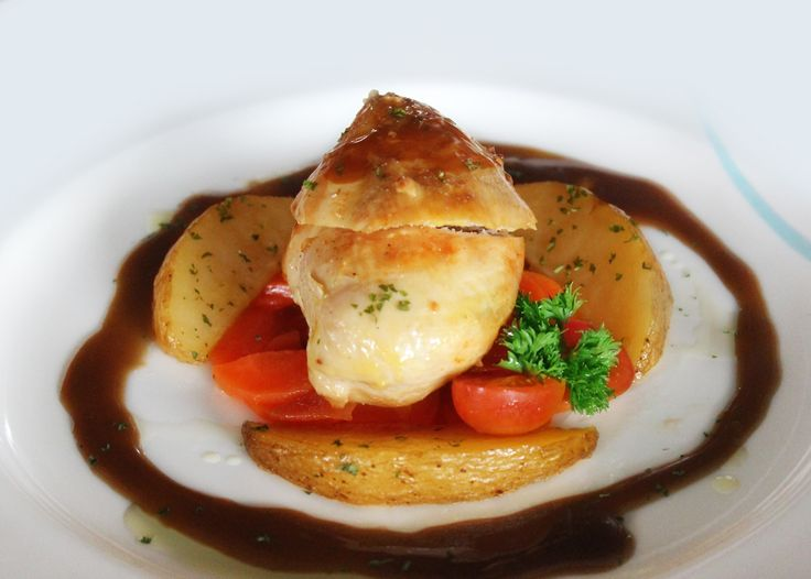 Enjoy the tempting Roasted Chicken Fillet. It has long been considered to be the test of a good chef. A simple dish that lends itself to signature touches. Coming with wedges herbs potato, soda carrot, and beef.