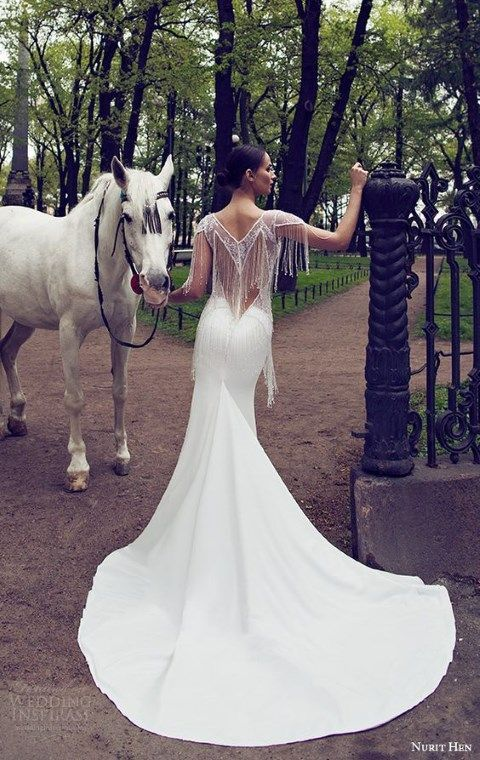 Fringe is a very uncommon type of detailing for a wedding gown but it looks so eye-catchy! Modern designers created fringe dresses in their wedding ...