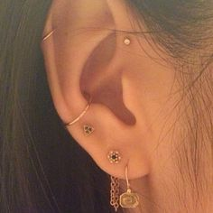 Forward helix, helix, conch and lobes piercings. Gold jeweleries from BVLA. I love how those piercings look toguether.
