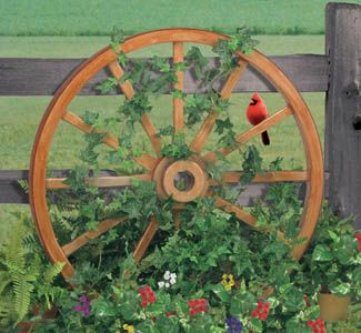 Love old wheels against a fence with flowers climbing on them. Look like the birds love them too. So pretty!!