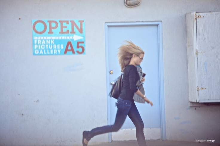 Woman running next to A door.  #losangeles #california #art #gallery #a5 #woman #running