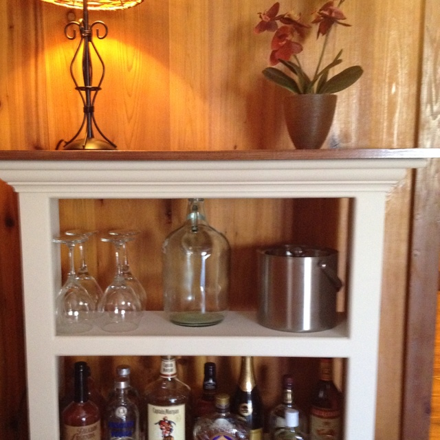 Bookshelf bar - old bookcase - added bun feet and a piece of stained wood for top.
