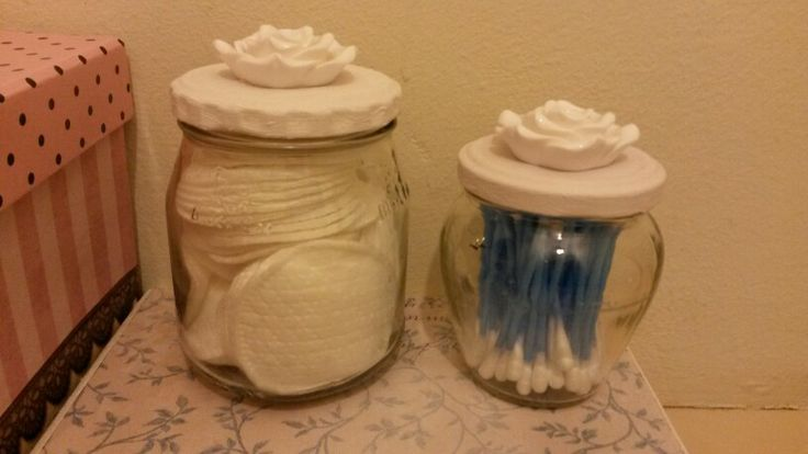 Old jars with painted lids used in the bathroom
