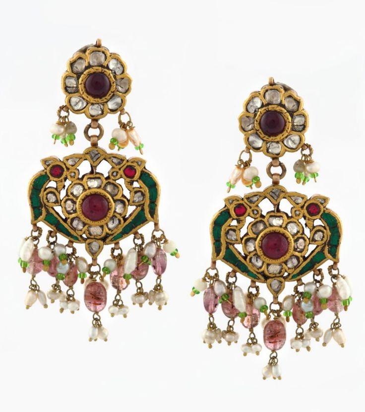 A PAIR OF 'PARROT' EAR PENDANTS. Each designed as a pair of stylized parrots flanking a flower, kundan-set with table-cut 'polki' diamonds, rubies and emeralds, and suspending a fringe of spinel beads and seed pearls, with a total gemstone weight of approximately 26.00 carats, and total diamond weight of approximately 2.15 carats, mounted in gold.