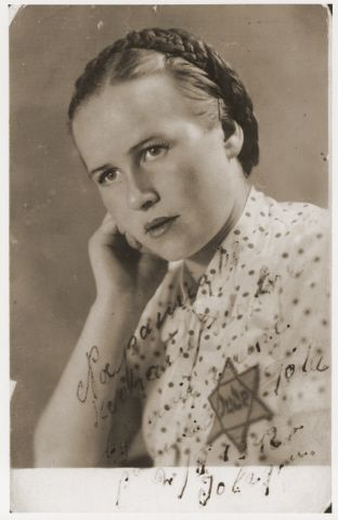 """Pictured is Tola Gryzgryn. This photograph was sent from the Sosnowiec ghetto to the Polanka labor camp, where her sister, Bronia Gryzgryn (now Bronia Rosmarin), was imprisoned. Tola was deported with her parents from Sosnowiec to Auschwitz, where they all perished. The Polish inscription on the photograph reads: """"To my dearest sister as a memento, so that you'll never forget me - Tola; Sepember 2, 1942."""""""