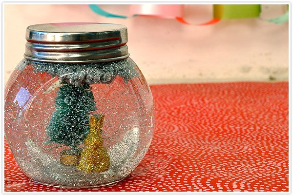 DIY Glitter Globe (homemade snow globe) Tho I think gluing the objects to the inside of the lid might be prettier...not sure.