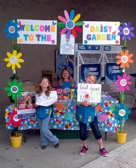 Cute Booth Idea!!! Welcome to the Daisy Garden! - Girl Scout Cookie Booth. There's girls have more money than we do.