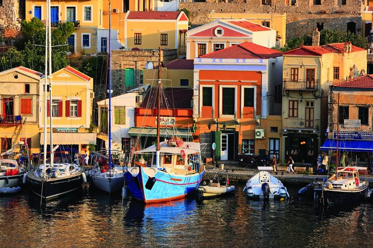 When you arrive in Symi you will be welcomed by the imposing homes of this multicoloured, neoclassical settlement! Learn more!  #Celestyalcruises #Symi #island #multicoloured #neoclassical #settlement