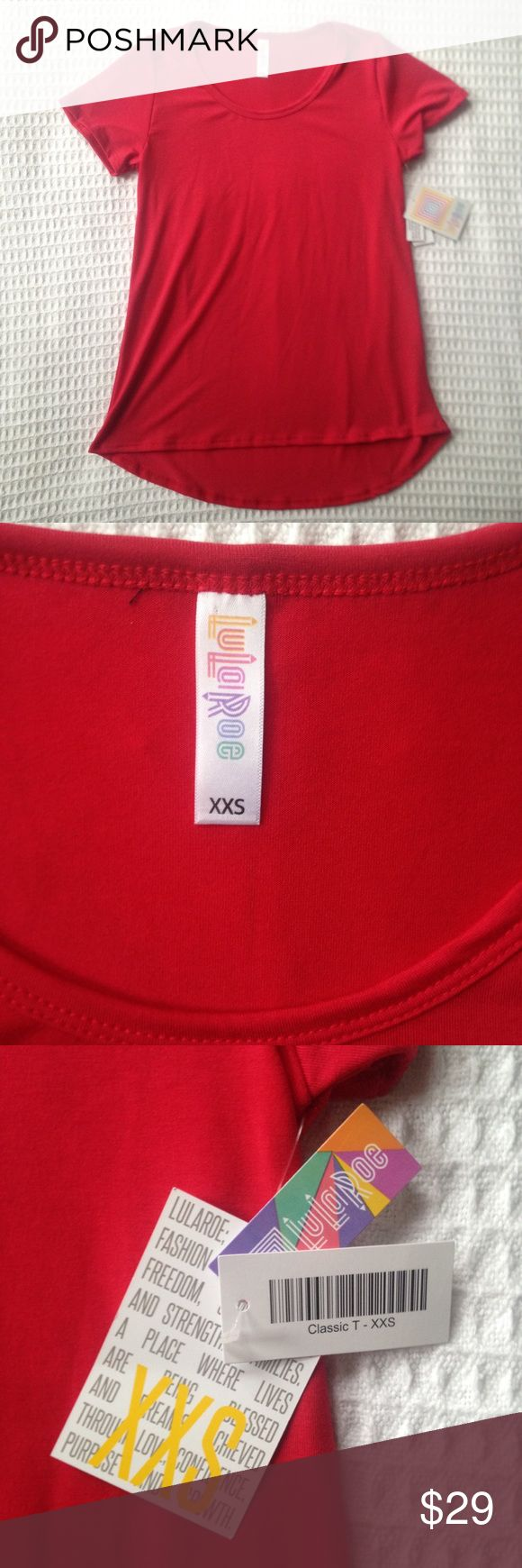 """NWT Lula Roe classic t red XXS The LuLaRoe """"Classic T"""" is sure to become a wardrobe staple as the perfect compliment to all your LuLaRoe skirts and  leggings. The Classic T is made from comfortable spun polyester jersey and is short sleeved with a high round neck line. As mentioned, the Classic T pairs well with leggings as the back is slightly longer to flatter bodies of all shapes and sizes. The Classic T is sure to become an essential foundational piece for a truly phenomenal wardrobe. No…"""