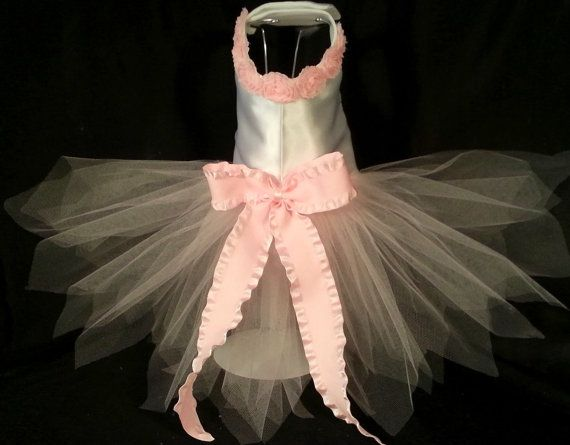 This fantasy tutu has a white satin bodice with a pink rose trim at the neck and is lined to ensure comfort. All inside seams are covered to