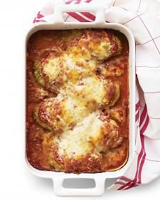 Skinless breast meat dipped in egg whites and ground whole-wheat crackers forms a good-for-you chicken parmigiana.