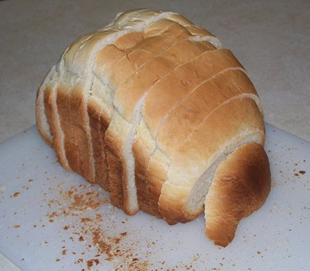 2 lb loaf using old / sour milk Excellent taste,crumb and texture Dense like a Pepperidge Farm brick oven , Holds up to a very thin slice