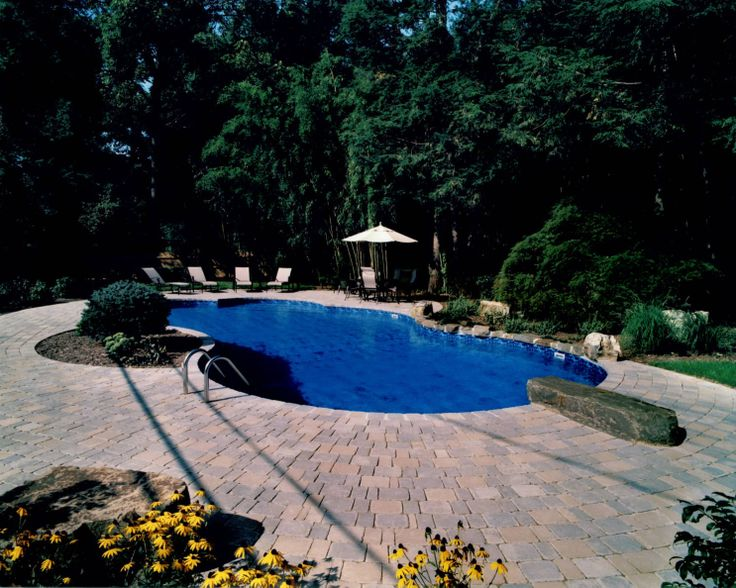 this is a 24' x 44' rolling lake pool. the pool has a brick coping