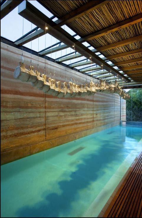rammed earth wall skylight pool timber beams... elegant