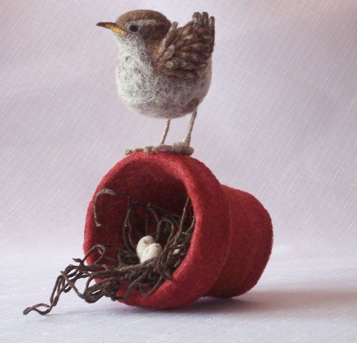 """Beautiful needle felt composition by Jackie Felix of Erie, Pennsylvania. She writes:   """"'Wren Ever' is one of my latest designs; as a bird watcher I am aware it's not technically correct,  but I was so inspired by a little wren who insisted on using a flower pot as a nest last spring  I decided to try and capture not only the experience of her determination, but also the anticipation of the arrival."""