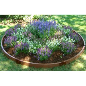 round garden idea to replace my rock gardens: Gardens Beds, Gardens Ideas, Rai Beds Gardens, Raised Beds Gardens, Front Yard, Rai Flowers Beds, Wood Grain, Gardens Edge, Circles Gardens
