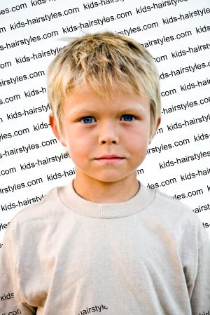 Boy's short brush forward hairstyle
