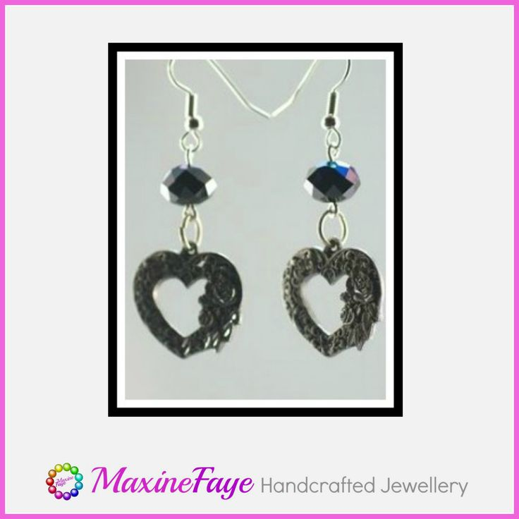 A 22x20mm pewter heart embossed with flowers drips from 7x10mm black AB faceted Chinese crystal rondelles to form these spectacular earrings.   The sparkling highlights on this charm is created by diamond-tipped cutting wheels.  The total length is approx 5.5cm and findings are silver plated.