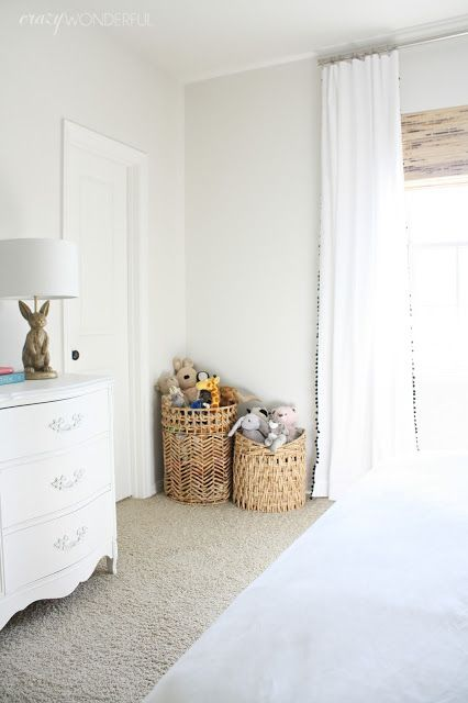 Crazy Wonderful: girl's bedroom, neutral girl's room, black and white girl's bedroom, pom pom curtains, white french dresser, Emily & Meritt bunny lamp, stuffed animal basket storage