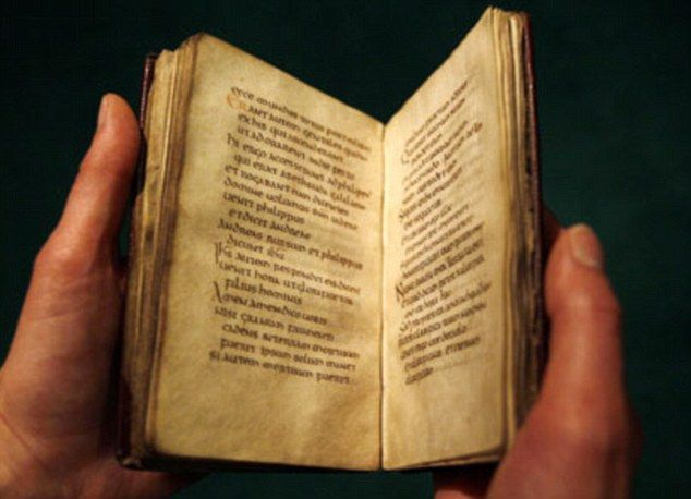 Europe's oldest book: St Cuthbert's gospel which survived pillaging Vikings and lay in his coffin for centuries is sold for £9m