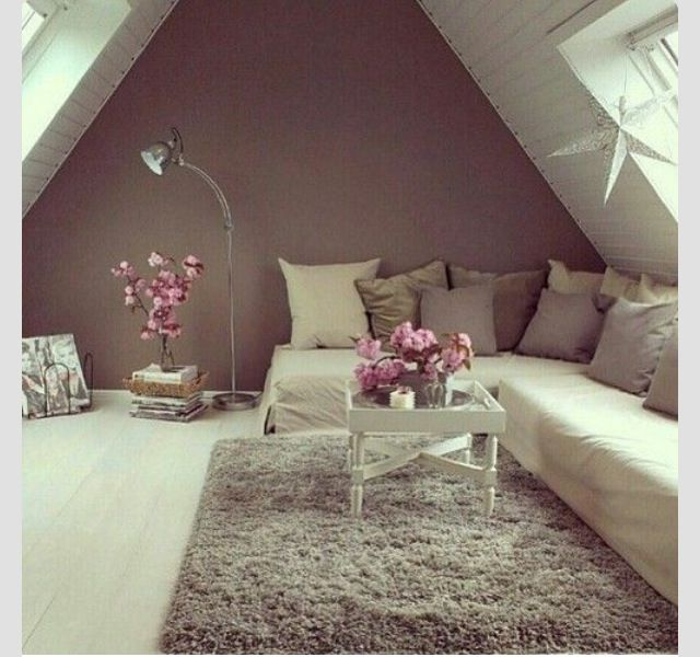 Basic starter room - silver star, neutral throw blanket, pillow cases, silver plate with candles, white table, silver lamp, mattress on the floor